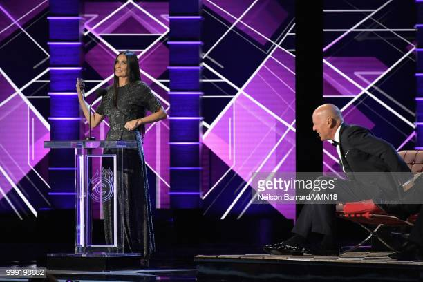 Bruce Willis reacts while Demi Moore speaks onstage during the Comedy Central Roast of Bruce Willis at Hollywood Palladium on July 14 2018 in Los...