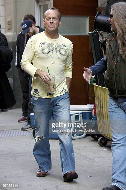 Bruce Willis walks back to his trailer after rehearsing a scene for the movie Perfect Stranger being filmed at Sapa restaurant on W 24th St Willis...