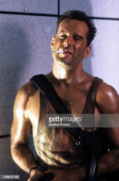 Bruce Willis with cigarette in a scene from the film 'Die Hard' 1988