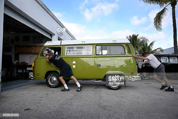 Bruce Wolczanski and Don Ammann push a 1976 Volkswagen camper bus into a garage bay for repair at their McNab Foreign Car garage which specializes in...