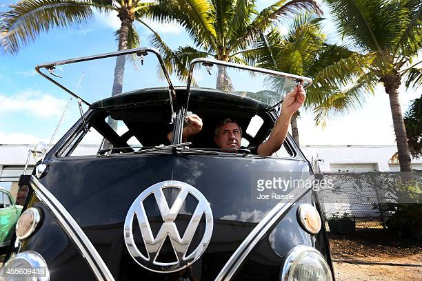 Bruce Wolczanski opens the window of a 1955 Volkswagen OvalWindow bus in the parking lot at his McNab Foreign Car garage that specializes in...