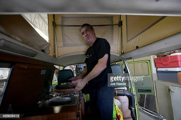 Bruce Wolczanski stands in the living space of a 1976 Volkswagen camper bus at his McNab Foreign Car garage that specializes in restoring VW vehicles...