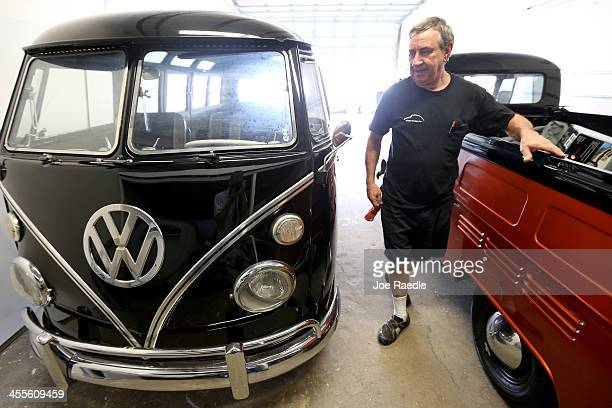 Bruce Wolczanski walks around a 1955 Volkswagen OvalWindow bus at his McNab Foreign Car garage that specializes in restoring VW vehicles on December...