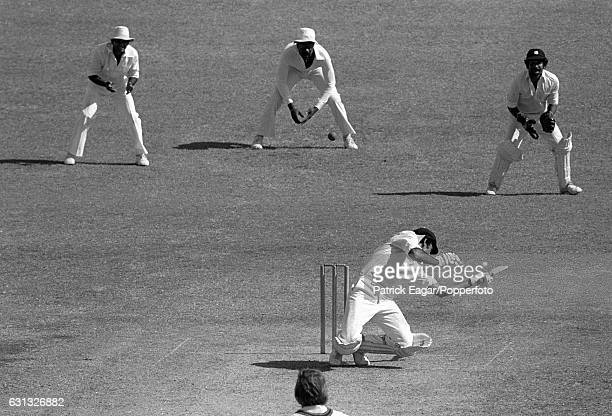 Bruce Yardley of Australia is hit by a bouncer from West Indies bowler Joel Garner during the 2nd Test match between West Indies and Australia at the...