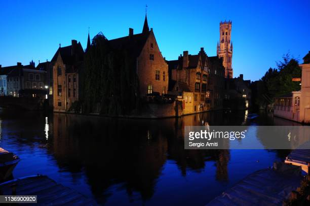 Bruges canal and Belfry at twilight