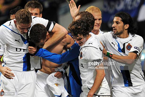 Bruge's forward Ivan Perisic is congratulated by teammates after scoring a goal during the UEFA Europa League football match Toulouse vs Bruges on...