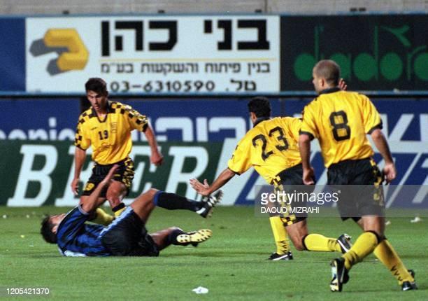 Bruges' Nordin Jbari lies on the ground as Beitar Jerusalem players Josef Abukasis , Harhzi and Istvan Pisont watch on during their first leg UEFA...