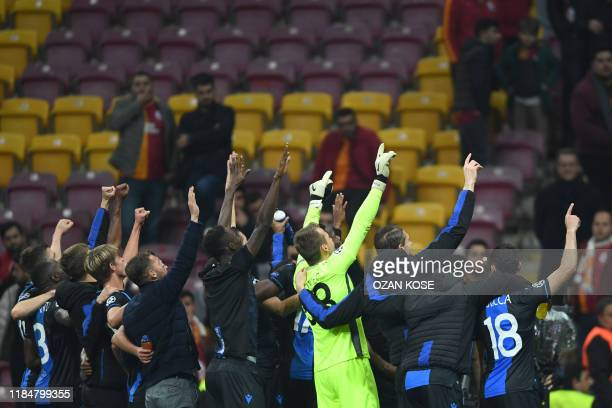 Bruges' players celebrate at the end of the UEFA Champions League football match between Galatasaray and Bruges on November 26 2019 AliSamiYen...