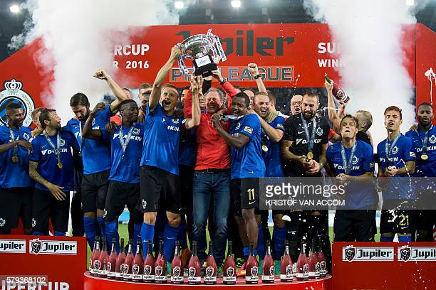 Brugge players and staff celebrate with the trophy after winning the football match between Club Brugge KV and Standard de Liege in the supercup...