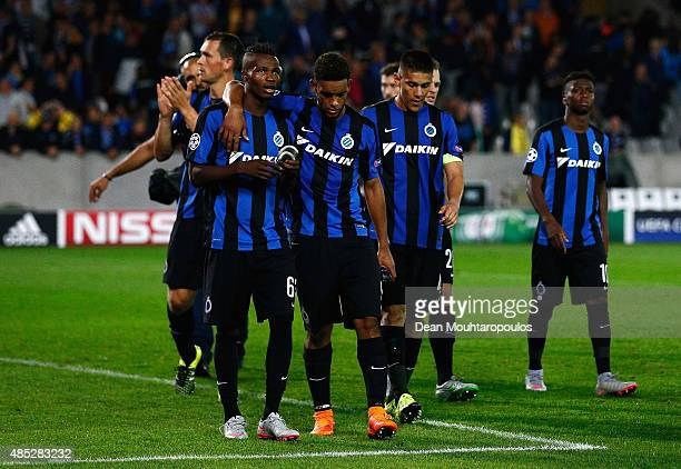 Brugge players look dejected after the UEFA Champions League qualifying round play off 2nd leg match between Club Brugge and Manchester United held...