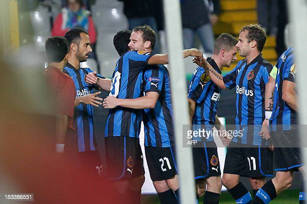Brugge's Carlos Bacca is congratulated by teammates after scoring during the UEFA Europa League Group D qualifying football match Brugge vs Maritimo...