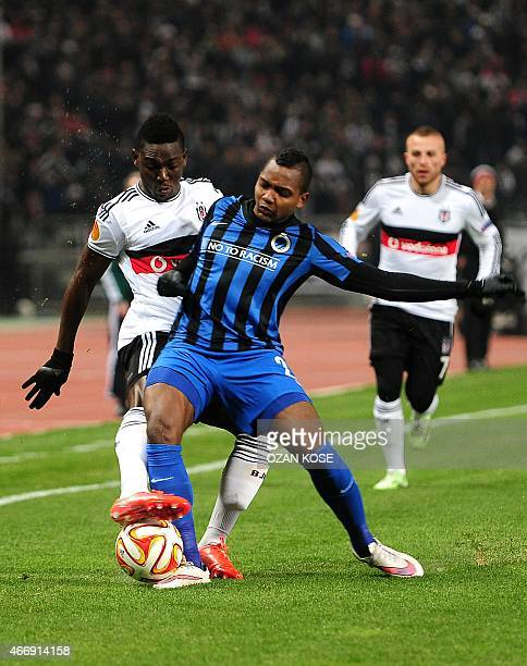 Brugge's Colombian forward Jose Izquierdo challenges Besiktas' Ghanaian defender Daniel Opare during the UEFA Europa League round of 16 football...