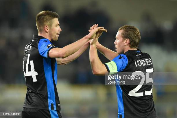 Brugge's defender Brandon Mechele and Brugge's midfielder Ruud Vormer celebrate their team's win of the UEFA Europa League round of 32 firstleg...