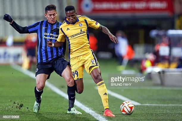 Brugge's Oscar Duarte and Helsinki's Macoumba Kandji vie for the ball during the UEFA Europa League group B football match between Club Brugge and...