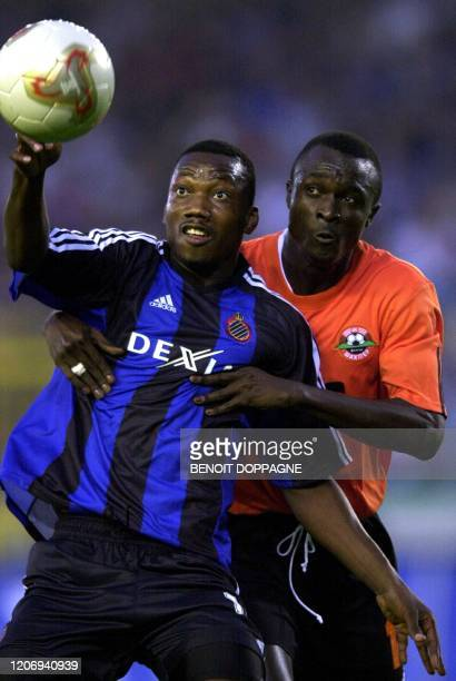 Brugge's Peruvian Andres Mendoza is chased by Donetsk's Assane Ndiaye during their third round qualifying match of the UEFA Champions League Club...