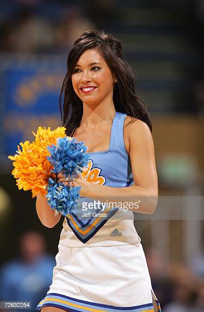 Bruin cheerleader cheers during the Exhibition game between the UCLA Bruins and the Cal Poly Pomona Broncos at Pauley Pavilion on November 2 2006 in...