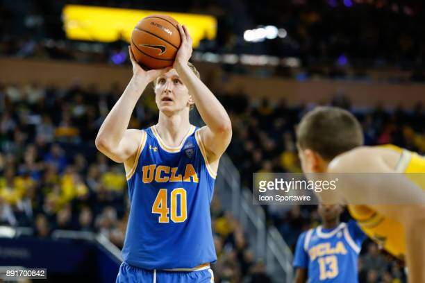 Bruins center Thomas Welsh shoots a free throw during a regular season nonconference basketball game between the UCLA Bruins and the Michigan...