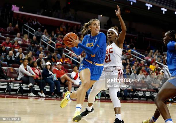 Bruins Chantel Horvat dribbles past USC Trojan Aliyah Mazyck during the game on December 30 at the Galen Center in Los Angeles CA
