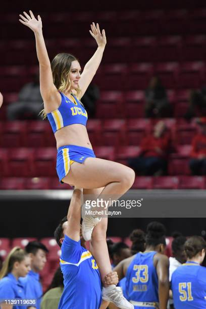 Bruins cheerleader performs during a NCAA Women's Basketball Tournament Second Round game against the Maryland Terrapins at the Xfinity Center Center...