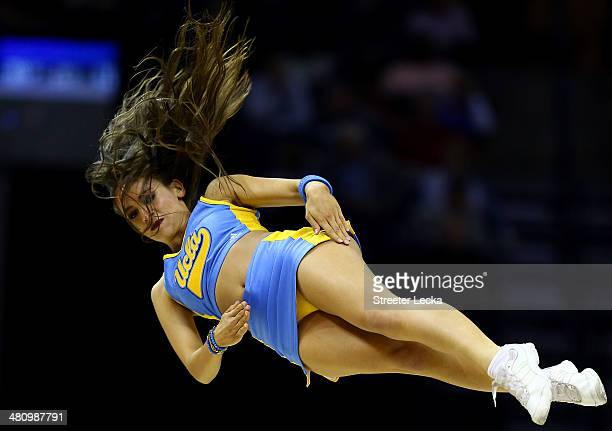 Bruins cheerleader performs during a regional semifinal of the 2014 NCAA Men's Basketball Tournament against the Florida Gators at the FedExForum on...