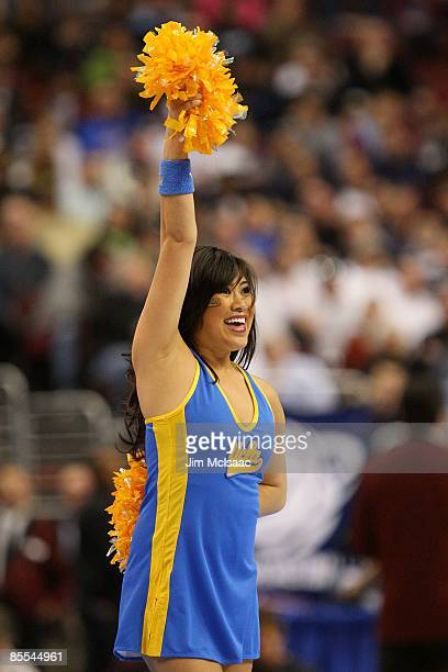 Bruins cheerleader performs during the game against the Villanova Wildcats during the second round of the NCAA Division I Men's Basketball Tournament...