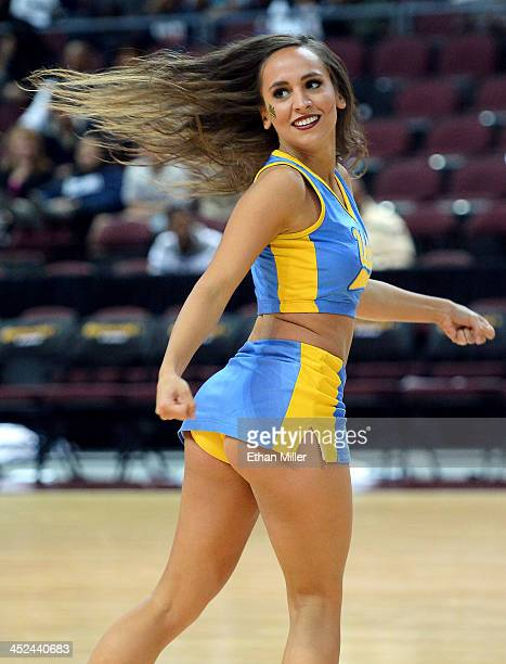 Bruins cheerleader performs during the team's game against the Nevada Wolf Pack during the Continental Tire Las Vegas Invitational at the Orleans...