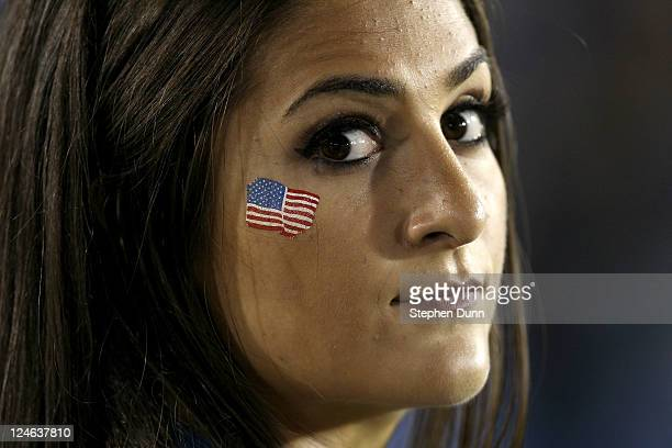 Bruins cheerleader wears an American flag decal on cheek in honor of the anniversary of the 9/11 attacks during the game with the San Jose State...