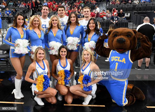 Bruins cheerleaders and mascot Joe Bruin pose before the team's semifinal game of the Pac12 basketball tournament against the Arizona Wildcats at...
