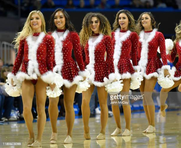 Bruins cheerleaders are dressed in Christmas inspired uniforms at one point during a game agaisnt San Jose State Spartans at Pauley Pavilion on...