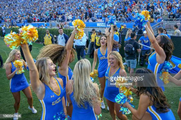 Bruins cheerleaders celebrate after a win during the USC Trojans game versus the UCLA Bruins on November 17 at the Rose Bowl in Pasadena, CA.