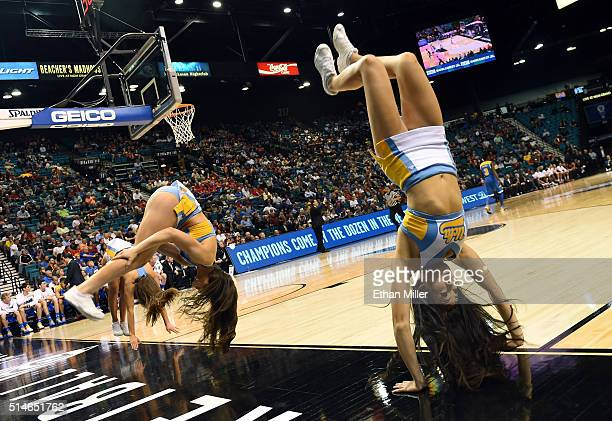 Bruins cheerleaders do backflips during a firstround game of the Pac12 Basketball Tournament against the USC Trojans at MGM Grand Garden Arena on...