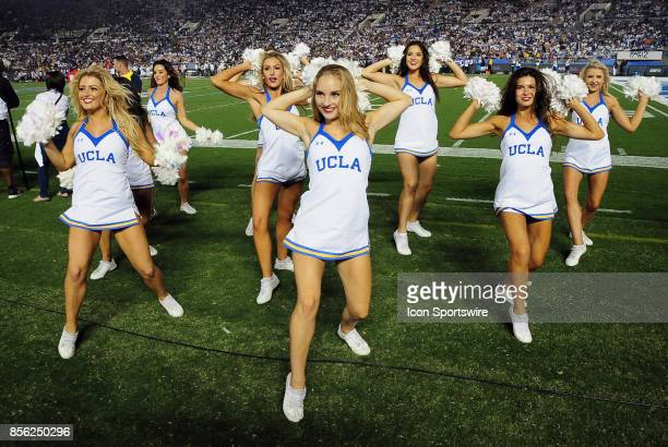 Bruins cheerleaders on the field during an NCAA football game against the Colorado Buffalo on September 30 played at the Rose Bowl in Pasadena CA