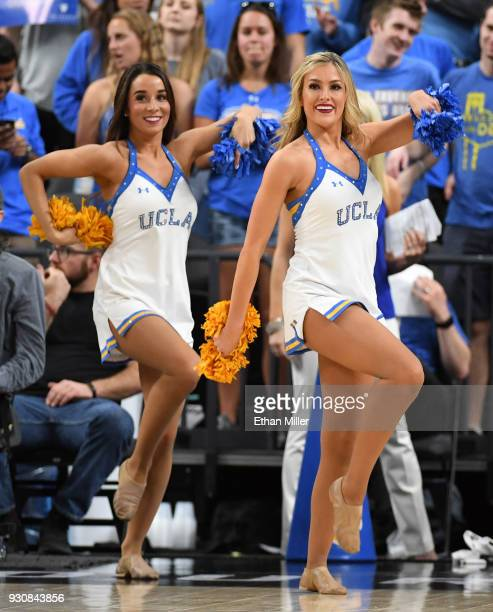 Bruins cheerleaders perform during a quarterfinal game of the Pac12 basketball tournament against the Stanford Cardinal at TMobile Arena on March 8...