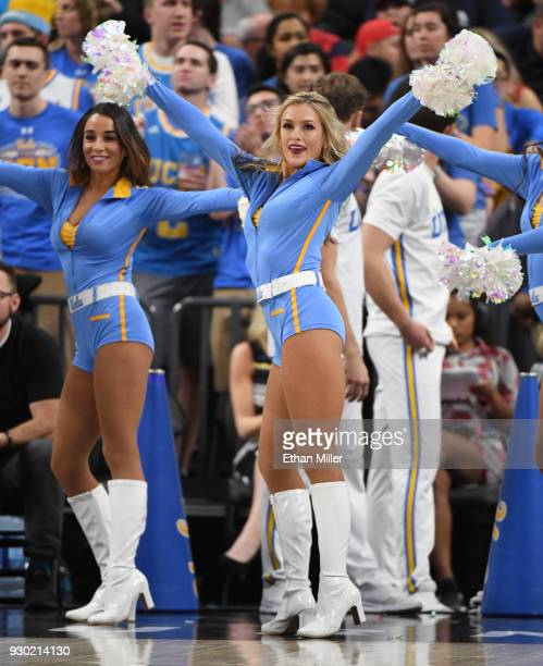 Bruins cheerleaders perform during the team's semifinal game of the Pac12 basketball tournament against the Arizona Wildcats at TMobile Arena on...