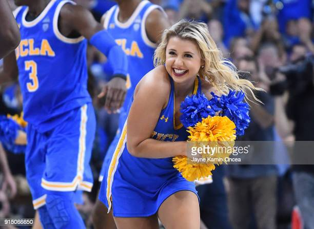 Bruins cheerleaders run on the court after the game against the USC Trojans at Pauley Pavilion on February 3 2018 in Los Angeles California