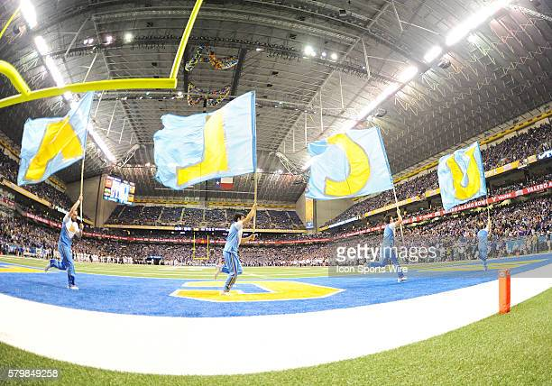 Bruins cheerleaders run with Flags across the endzone during the 2015 Alamobowl in the Alamodome in San Antonio Texas