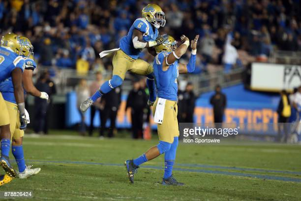 Bruins defensive back Adarius Pickett celebrates with UCLA Bruins defensive lineman Jaelan Phillips after Phillips gets a sac during the game against...
