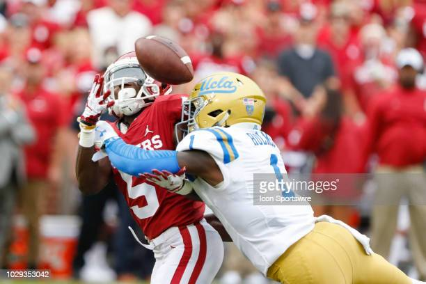 Bruins defensive back Darnay Holmes breaks up a catch by Oklahoma Sooners wide receiver Marquise Brown during first quarter of the UCLA Bruins game...
