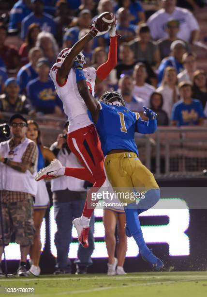 Bruins defensive back Darnay Holmes breaks up a pass to Fresno State Bulldogs wide receiver KeeSean Johnson during the game between the Fresno State...