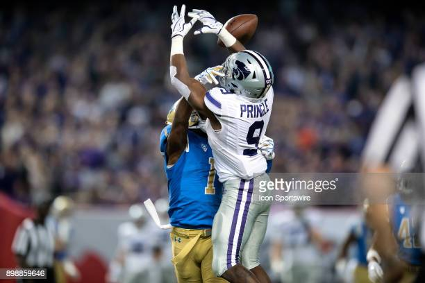 Bruins defensive back Darnay Holmes breaks up a pass to Kansas State Wildcats wide receiver Byron Pringle during the Motel 6 Cactus Bowl college...