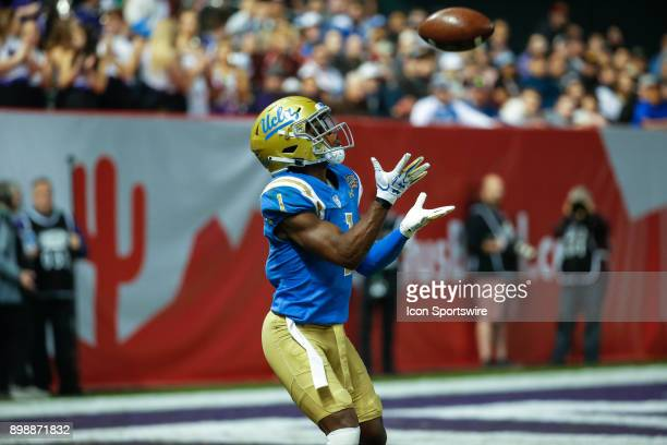 Bruins defensive back Darnay Holmes receives a kick off during the Cactus Bowl college football game between the Kansas State Wildcats and the UCLA...