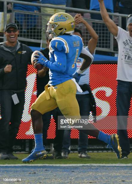 Bruins defensive back Darnay Holmes returns a kick for a touchdown in the second half of a game against the Stanford Cardinal played on November 24...
