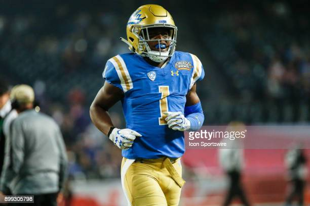 Bruins defensive back Darnay Holmes runs onto the field before the Cactus Bowl college football game between the Kansas State Wildcats and the UCLA...