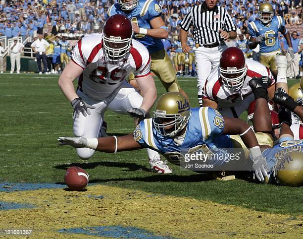Bruins defensive end Brigham Harwell scores on a fumble recovery in the end zone for a touchdown against the Washington State Cougars Saturday...