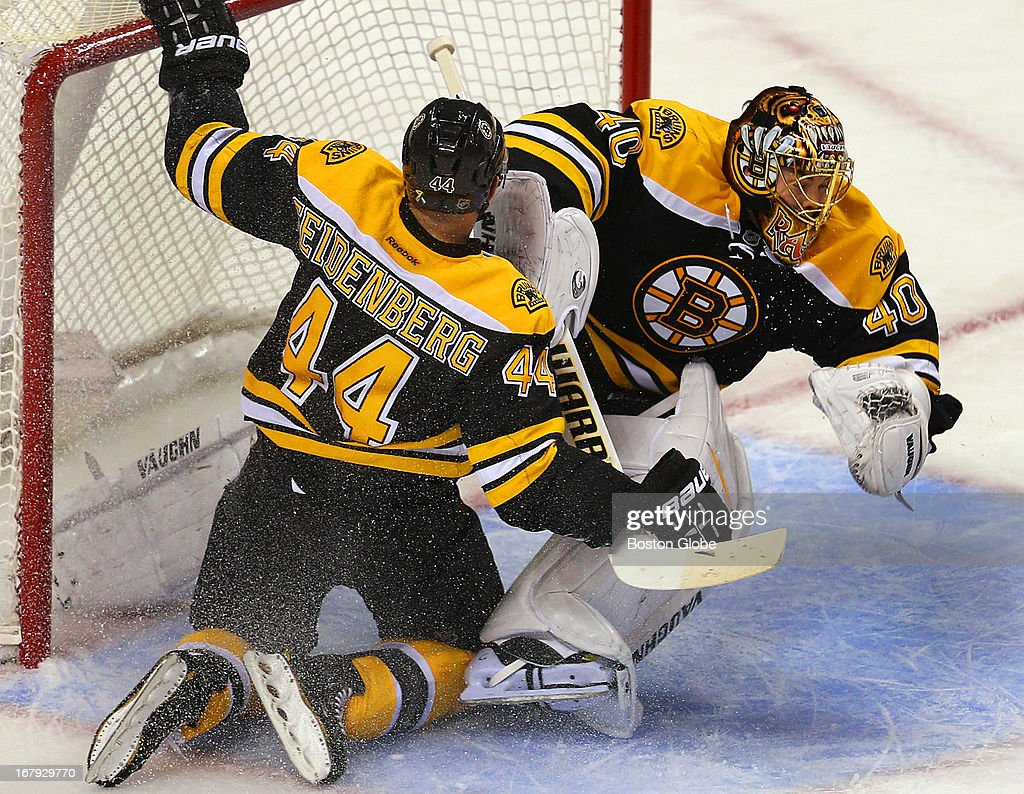 Bruins Dennis Seidenberg collides with goalie Tuukka task in the first period. The Boston Bruins host the Toronto Maple Leafs in the first game of the Eastern Conference quarterfinals at TD Garden.