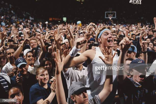Bruins fans enthusiastically celebrate a 74-67 win over the Oregon State Beavers to win the NCAA Pac-10 college basketball championship title on 1...