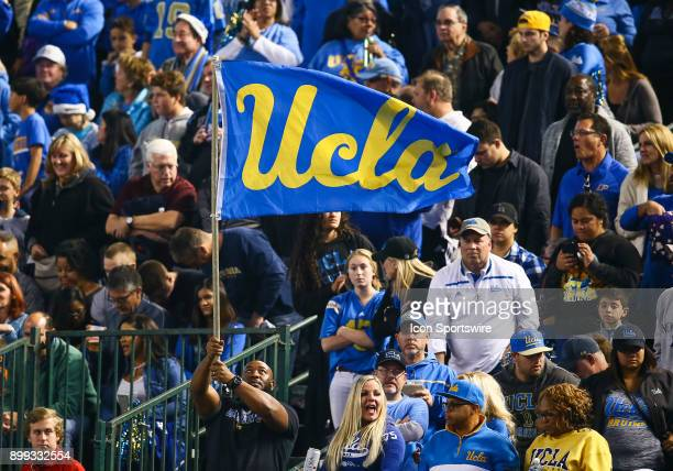 Bruins fans fly their flag in the crowd during the NCAA football Cactus Bowl game between the Kansas State Wildcats and the UCLA Bruins on December...