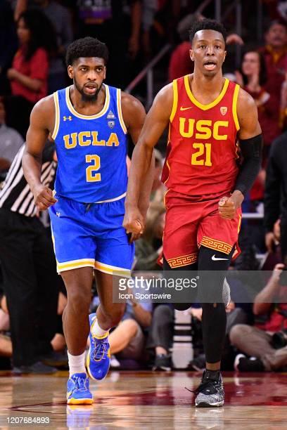 Bruins forward Cody Riley and USC Trojans forward Onyeka Okongwu look on during the college basketball game between the UCLA Bruins and the USC...