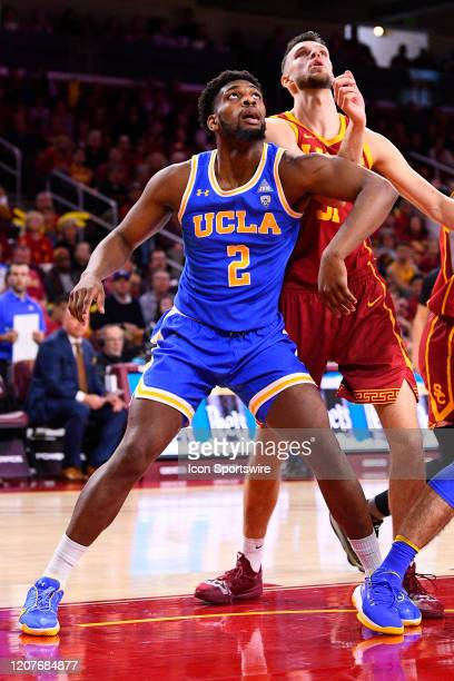 Bruins forward Cody Riley boxes out USC Trojans forward Nick Rakocevic for a rebound during the college basketball game between the UCLA Bruins and...
