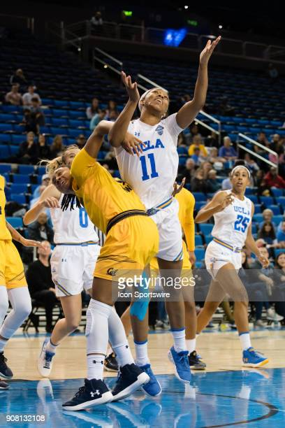 Bruins forward Lajahna Drummer gets tangled up with California Golden Bears guard Jaelyn Brown during the game between the Cal Berkeley Golden Bears...